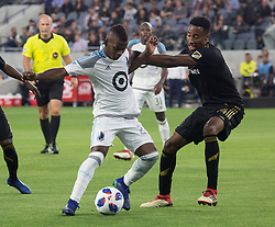 May 9, 2018 - Los Angeles, California, U.S - Mark-Anthony Kaye #14 of the LAFC battles for the ball with Darwin Quintero #25 of the Minnesota United FC on Wednesday May 9, 2018, at the Banc of California Stadium in Los Angeles, California. LAFC defeats Minnesota United FC, 2-0. (Credit Image: © Prensa Internacional via ZUMA Wire)