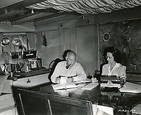 1940 Cecil B DeMille and his secretary, Gladys Rosson, after a days filming