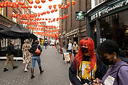 People out and about in Chinatown on 25th May 2021 in London, United Kingdom. As the coronavirus lockdown continues its process of easing restrictions, more and more people are coming to the West End as more businesses open.