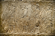Assyrian relief sculpture panel of spearmen lining the road from the King Ashurnasirpal lion hunt.  From Nineveh  North Palace, Iraq,  668-627 B.C.  British Museum Assyrian  Archaeological exhibit no ME 120859 .<br /> <br /> If you prefer to buy from our ALAMY PHOTO LIBRARY  Collection visit : https://www.alamy.com/portfolio/paul-williams-funkystock/ancient-assyria-antiquities.html  Refine search by adding background colour, place, subject, museum etc into the LOWER SEARCH WITHIN GALLERY box to <br /> <br /> Visit our ANCIENT ASSYRIAN PHOTO COLLECTIONS for more photos to download or buy as wall art prints https://funkystock.photoshelter.com/gallery-collection/Ancient-Assyrian-Art-Artefacts-Antiquities-Historic-Sites-Pictures-Images-of/C0000cjRqQyJjLag
