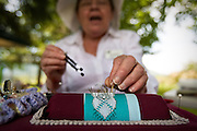 Joy Irving of Moscow, Idaho describes the intricacies of lace designs while working on a bookmark pattern at the Skills Fair at Mission Hill in Cataldo.