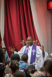 27 October 2019, Addis Ababa, Ethiopia: Rev. Tekle Ayele blesses the congregation's children as they gather around the altar. Sunday service at the Finfinne Oromo Mekane Yesus Congregation of the Ethiopian Evangelical Church Mekane Yesus. In a context where congregations did not use to be allowed to hold their services in any language but Amharic, the congregation today is one of some 60 Oromo speaking Mekane Yesus congregations in Addis Ababa. The service takes place on the first Sunday following political turmoil in the country, claiming dozens of lives.