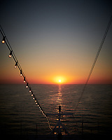 Sunrise on the English Channel from the aft deck of the MV Explorer. Image taken with a Leica X2 camera (ISO 100, 24 mm, f/5.6, 1/400 sec).