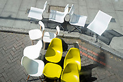 An assortment of plastic seats are arranged randomly at the kerbside near Elephant & Castle in south London, on 29th April 2021, in London, England.