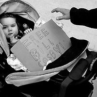 NORRISTOWN, PA - APRIL 24: David Joseph Jr., 1, holds a sign in support of Bill Cosby, placed in his stroller by his parents, outside the Montgomery County Courthouse on the twelfth day of his sexual assault retrial on April 24, 2018 in Norristown, Pennsylvania. The jury is expected to begin deliberations tomorrow. A former Temple University employee alleges that the entertainer drugged and molested her in 2004 at his home in suburban Philadelphia. 60 women have accused the 80 year old entertainer of sexual assault. (Photo by Mark Makela/Getty Images)
