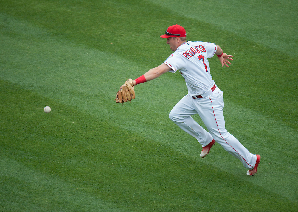 Angels shortstop Cliff Pennington can't get to this blooper against the Houston Astros Sunday at Angel Stadium. <br /> <br />  //ADDITIONAL INFO:   <br /> <br /> angels.0530.kjs  ---  Photo by KEVIN SULLIVAN / Orange County Register  -- 5/29/16<br /> <br /> The Los Angeles Angels take on the Houston Astros Sunday at Angel Stadium.