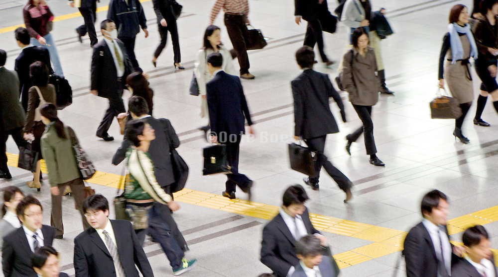 overhead view of commuters Tokyo Japan