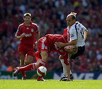 Photo: Jed Wee.<br />Liverpool v Tottenham Hotspur. The Barclays Premiership. 23/09/2006.<br /><br />Tottenham's Danny Murphy (R) holds off Liverpool's Dirk Kuyt.