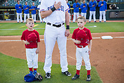 Ryan Cullison, left, and Caden Pitman, right, sing the national anthem before the start of a Round Rock Express baseball game in Round Rock, Texas.