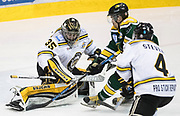 Victoria Grizzlies goaltender Mathew Galajda makes a save on Kings forward Carter Turnbull at the Q Centre in  Colwood, British Columbia Canada on March 27, 2017.