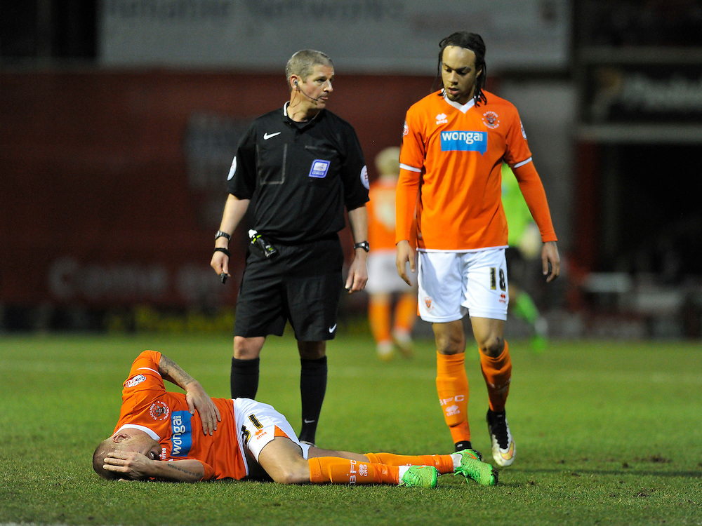 Blackpool's Jamie O'Hara went off injured in the first half<br /> <br /> Photographer Ashley Western/CameraSport<br /> <br /> Football - The Football League Sky Bet League One - Brentford v Blackpool - Tuesday 24th February 2015 - Griffin Park - London<br /> <br /> © CameraSport - 43 Linden Ave. Countesthorpe. Leicester. England. LE8 5PG - Tel: +44 (0) 116 277 4147 - admin@camerasport.com - www.camerasport.com