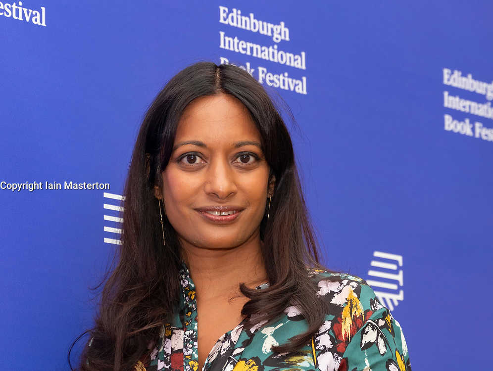 """Edinburgh, Scotland, UK. 26 August, 2018. Pictured; Dharshini David the economist and broadcaster. Her book """"The Almighty Dollar"""" followed the money finding that globalisation would buckle without the vast reserves of dollars circulating, even aside from the enormous numbers of dollars kept in vaults by some countries."""