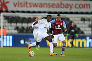 Bafetimbi Gomis of Swansea city breaks away from Jordan Ayew of Aston Villa. Barclays Premier league match, Swansea city v Aston Villa at the Liberty Stadium in Swansea, South Wales on Saturday 19th March 2016.<br /> pic by  Andrew Orchard, Andrew Orchard sports photography.