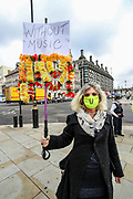 Helen Brice is psychology therapist, also a flute and piano player hold placards as she attends Musicians who are gathered in Parliament Gardens, outside the Houses of Commons in London, on Tuesday, Oct 6, 2020. Musicians in Britain are using their voices and instruments to protest against the government instructions to retrain and lack of support to the industry. (VXP Photo/ Vudi Xhymshiti)