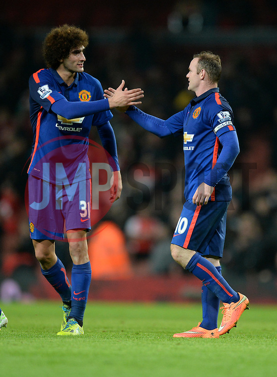 Manchester United's Marouane Fellaini shakes hands with Manchester United's Wayne Rooney at the final whistle. - Photo mandatory by-line: Alex James/JMP - Mobile: 07966 386802 - 22/11/2014 - Sport - Football - London - Emirates Stadium - Arsenal v Manchester United - Barclays Premier League