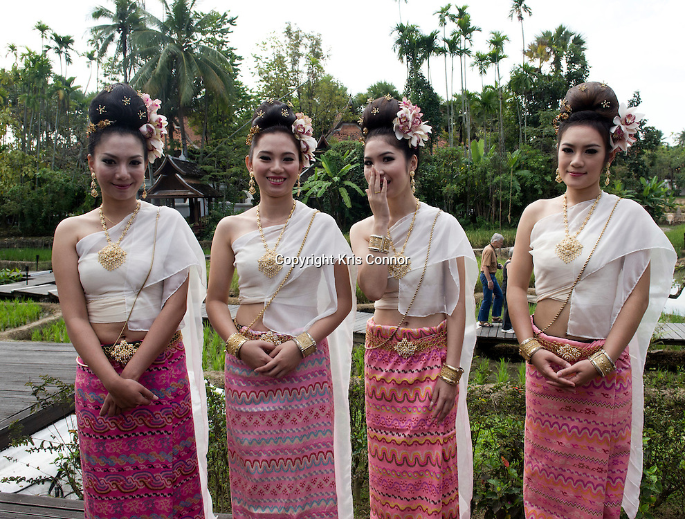 A group of girls pose for a photo during Lanna wedding ceremony at the Mandarin Oriental resort in Chiang Mai, Thailand. Photo by Kris Connor