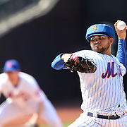 Pitcher Alex Torres, New York Mets, wearing protective head gear, pitching during the New York Mets Vs Washington Nationals MLB regular season baseball game at Citi Field, Queens, New York. USA. 3rd May 2015. Photo Tim Clayton