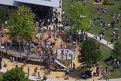 Stock photo of an aerial view of people enjoying the playground in the park