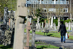 © Licensed to London News Pictures. 22/04/2012. Hammersmith, UK . A woman walks throughout the cemetery. General Views taken today 22 April 2012 of Hammersmith Cemetery. Doctors are battling to save the sight of a senior British diplomat mugged while walking through the cemetery on Friday night (20/04/12). Bermuda's new Governor George Fergusson may lose his vision in his left eye after being attacked by a man in Hammersmith Cemetery, west London, said police. Photo credit : Stephen Simpson/LNP