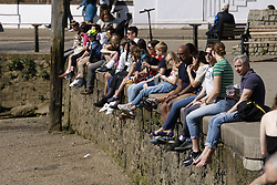© Licensed to London News Pictures. 30/03/2021. London, UK. People enjoy the sunny weather at Richmond-Upon-Thames. Temperatures are expected to reach 22C later today. Covid regulations have changed to allow gatherings up to six people outdoors. Photo credit: Peter Macdiarmid/LNP