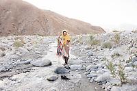 Earth celebration ceremonial river trek. Spiritual traveler on her sacred shamanic journey.