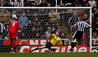 Photo. Jed Wee.<br /> Newcastle United v Liverpool, FA Barclaycard Premiership, St. James' Park, Newcastle. 06/12/03.<br /> Newcastle's Alan Shearer (R) sends Chris Kirkland the wrong way to convert the penalty.