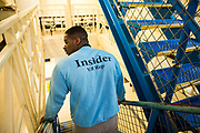 A prisoner wearing an Insider jumper walking down the wing stairs. HMP/YOI Portland, United Kingdom