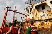 "Chinese Zombie Ships off the coast of West Africa, March-April 2006. These ships are engaged in IUU - illegal, unreported and unregulated fishing off the coast of Guinea, West Africa. The ships themselves have not been in port for perhaps ten years - they crew don't see land for up to two years. The Greenpeace ship Esperanza, with Greenpeace, Environmental Justice Foundation and Guinean authorities participated in the arrest of one of these vessels - on board were boxes for a ship of another name, and with the words ""product of Spain"". The crewmen, who are essentially indentured labourers live in appalling conditions on board. Some of the vessels no longer function, and are left at anchor offshore, with a skeleton crew on board. Later on the expedition, the Esperanza caught some of the working vessels transhipping boxes to a Korean 'reefer', which it then pursued to Las Palmas, in the Canary Islands. Activists blocked the ship's cranes in for many days over Easter 2006, leading to the seizing of 11,000 boxes fishing stolen from the waters of West Africa and destined for the European market. The fish was returned to Guinea."