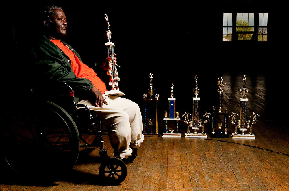Matt Dixon   The Flint Journal..Raymond Jones, 54, of Flint poses for a portrait in the Berston Fieldhouse with several of the trophies he won as a basketball coach. Jones, who is battling a list of health issues including  kidney disease and diabetes, was huge on the AAU basketball circuit with 12 of his teams winning AAU state titles.