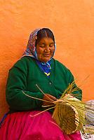 Tarahumara Indian woman weaving baskets outside the Posada Barrancas Mirador Hotel, Copper Canyon, near Divisadero, Mexico