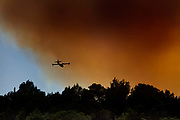 Firefighting plane carrying seawater to fight an out of control fire, the smoke obscuring the afternoon sun on the 14th August 2019, Lagrasse, France The burning of fossil fuels to make electricity is the largest source of heat-trapping pollution, producing about two billion tons of CO2 every year. Coal-burning power plants are by far the biggest polluters. The country's second-largest source of carbon pollution is the transportation sector.