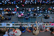 People look out on the balcony before the start of the Kentucky Derby.