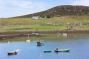 Fisherman in Old Dornie Harbour near the Summer Isles, part of the Inner Hebrides,  on the West Coast of Scotland