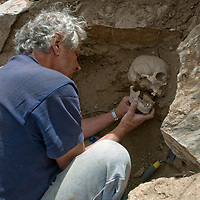 Smithsonian archaeologist & forensics specialist, Dr. Bruno Frohlich, unearths a bronze-age skull at a site above Delger River near Muren, Mongolia.  This   may be 2700+ years old.