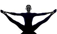 woman exercising stretching splits yoga silhouette shadow white background