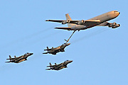 3 Israeli Air force Fighter jet F15C being refueled by a Boeing 707 in flight