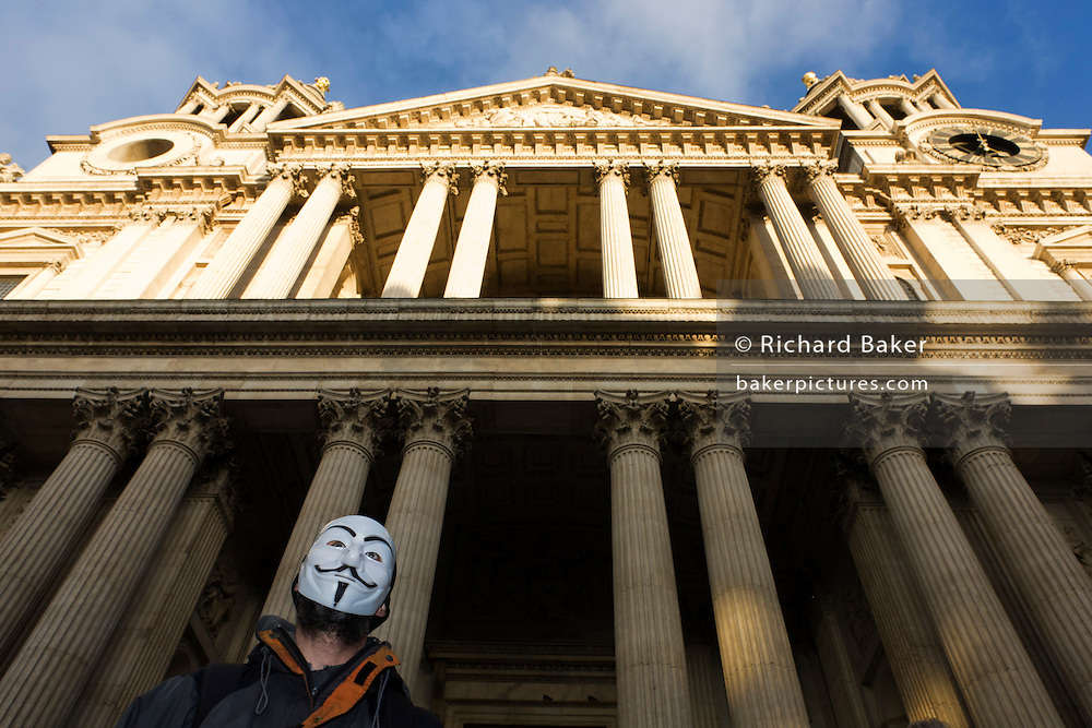 Anti-capitalist wears Anonymous mask on the 11th day of the Occupy London protest camp in St Paul's cathedral churchyard, London 26/11/11. City lawyers are using medieval pedestrian bylaws to gain a court injunction to evict the activists who set up tents and shelters as in other countries.