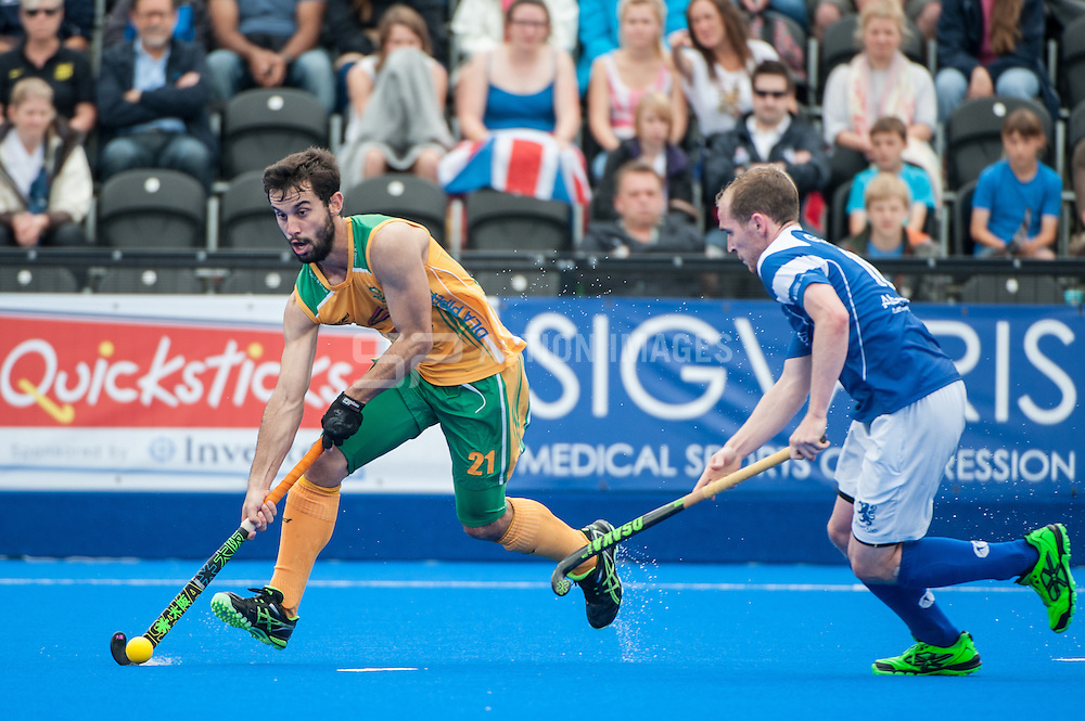 Jethro Eustice (RSA) is challenged by Gordon McIntyre (SCO). Scotland v South Africa, 3rd/4th play-off, Investec London Cup, Lee Valley Hockey & Tennis Centre, London, UK on 13 July 2014. Photo: Simon Parker