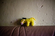 A toy In the flat of Ondrej Ziga (50) and his wife Janeta (42) - they both have together 8 children and are living in a building at Lunik IX, a decrepit housing complex almost entirely populated by Roma.
