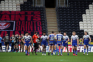 St Helens players celebrate after scoring a try  during the Betfred Super League match between Hull FC and St Helens RFC at Kingston Communications Stadium, Hull, United Kingdom on 16 February 2020.