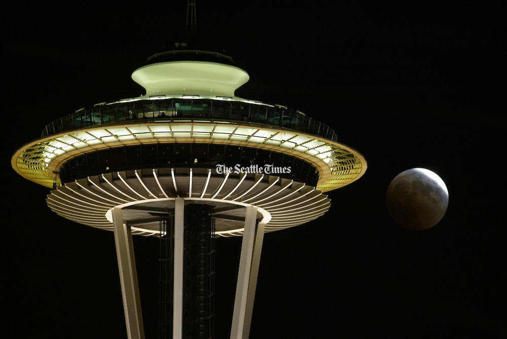 A total lunar eclipse rises behind the Space Needle. (Rod Mar / The Seattle Times, 2004)