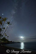 a waxing moon shines through clouds and reflects on the water as the Milky Way rises above Anaeho'omalu Bay, Waikoloa Resort Area, South Kohala, Hawaii Island ( the Big Island ), Hawaii, U.S.A. ( Central Pacific Ocean )