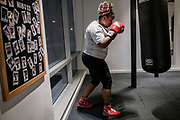 WASHINGTON, DC - NOVEMBER 14: Vermecia Alsop, 35, of Washington, DC, participates in a boxing conditioning class at NUBOXX on Wednesday, November 14, 2018 in Washington, DC. Once a sweaty, gritty environment of men, the recent trend of fitness boxing is now all about brightly-lit studios and fresh millennial faces working the heavy or speed bag. (Photo by Pete Marovich For The Washington Post)