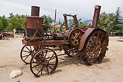 Antique rusting tractor at the Eastern California Museum, 155 N. Grant Street, Independence, California, 93526, USA. The Museum was founded in 1928 and has been operated by the County of Inyo since 1968. The mission of the Museum is to collect, preserve, and interpret objects, photos and information related to the cultural and natural history of Inyo County and the Eastern Sierra, from Death Valley to Mono Lake.