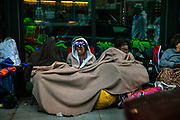 Camping out for a good position for a parade during Mardi Gras on 25th February 2020 in New Orleans, Louisiana, United States. Mardi Gras is the biggest celebration the city of New Orleans hosts every year. The magnificent, costumed, beaded and feathered party is laced with tradition and  having a good time. Celebrations are concentrated for about two weeks before and culminate on Fat Tuesday the day before Ash Wednesday and Lent.