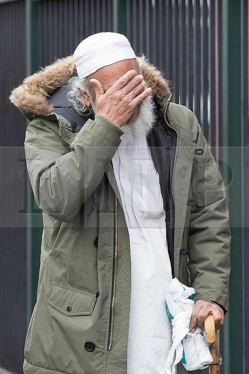 © Licensed to London News Pictures . 01/03/2016 . Manchester , UK . Shahzaib's Uncle MOHAMMED HUSSAIN cries outside the Masjid Hamza Mosque on Moss Lane West in Ashton Under Lyne , at the scene where 11 year old Shahzaib Hussain was killed by a hit and run driver yesterday evening (Monday 29th February 2016) . Photo credit : Joel Goodman/LNP