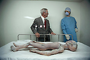 Alien autopsy. Retired mortician, Glenn Dennis, with a replica of an alien body at the International UFO Museum and Research Center in Roswell, USA. The town has tourist attractions around the theme of UFO's. It was near Roswell on 2 July 1947 that many UFO sightings were reported during a thunderstorm. Strange wreckage was found in a field and when the impact site was located, a UFO craft and alien bodies were allegedly found and an autopsy conducted. On 8 July 1947, the Roswell Daily Record announced the capture of a flying saucer. Many Roswell inhabitants, however, believe aliens had arrived. Model Released (1997)