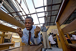 October 9, 2016 - HTI - Idernier Douze 31, worships at L'Elise de Dieu in Morne la Source, Haiti on Sunday, Oct. 9, 2016. The church's roof was lost in Hurricane Matthew. (Credit Image: © Patrick Farrell/TNS via ZUMA Wire)