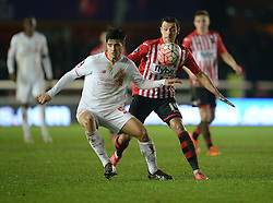 Joao Teixeira of Liverpool and Alex Nicholls of Exeter City - Mandatory byline: Alex James/JMP - 08/01/2016 - FOOTBALL - St James Park - Exeter, England - Exeter City v Liverpool - FA Cup Third Round