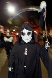 13 Feb 2015. New Orleans, Louisiana.<br /> Mardi Gras. Walking with the Skeleton Krewe along Magazine Street as the Krewe D'Etat rolls.<br /> Photo; Charlie Varley/varleypix.com